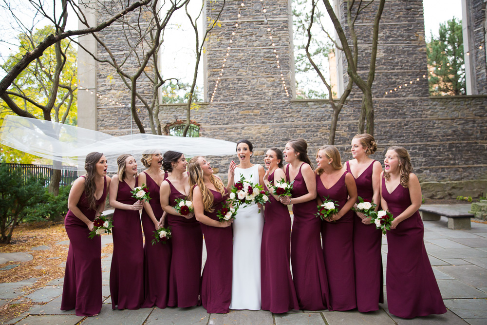 Fun Wedding Photography in Western New York | Burgundy bridesmaid dresses by Vera Wang