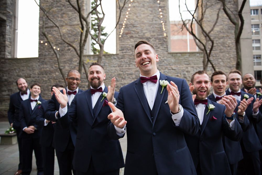 Funny groomsmen photo | Mighty Ducks and the Flying V | Candid Wedding Photographer in Rochester, NY | Suits by Joseph Abboud at Men's Wearhouse
