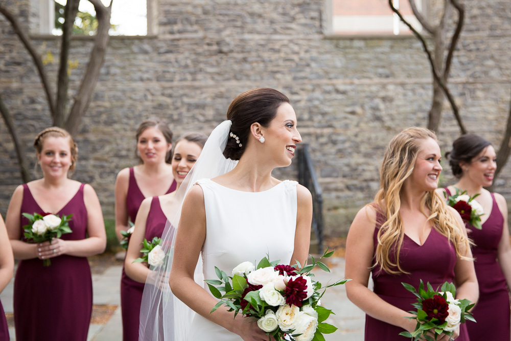Candid wedding photo of bride and bridesmaids in Rochester | Hair and makeup by Polished Salon