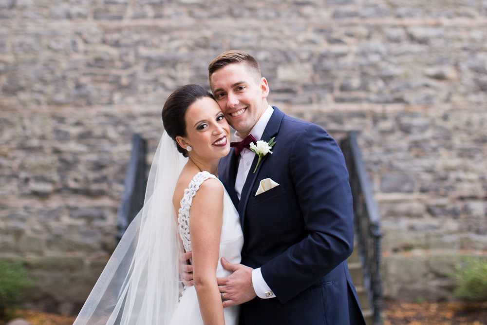 Happy couple on their wedding day | St. Joseph's Park | Best Wedding Photo Locations in Rochester, NY | Wedding hair and makeup by Polished Salon