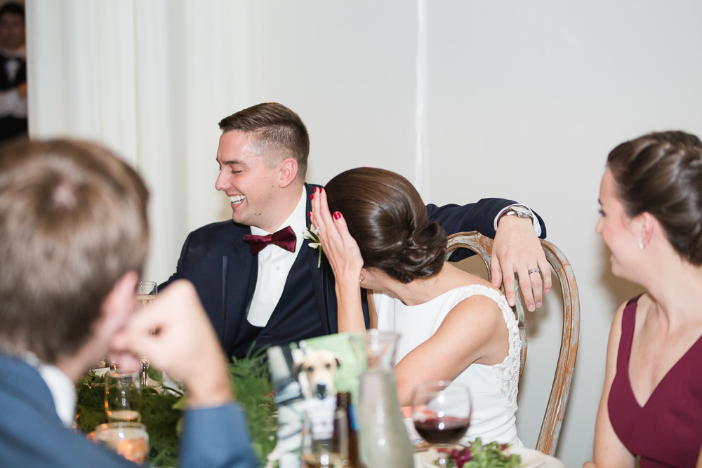 Wedding couple laughing during the reception at Arbor Loft, Rochester NY | Documentary Wedding Photography