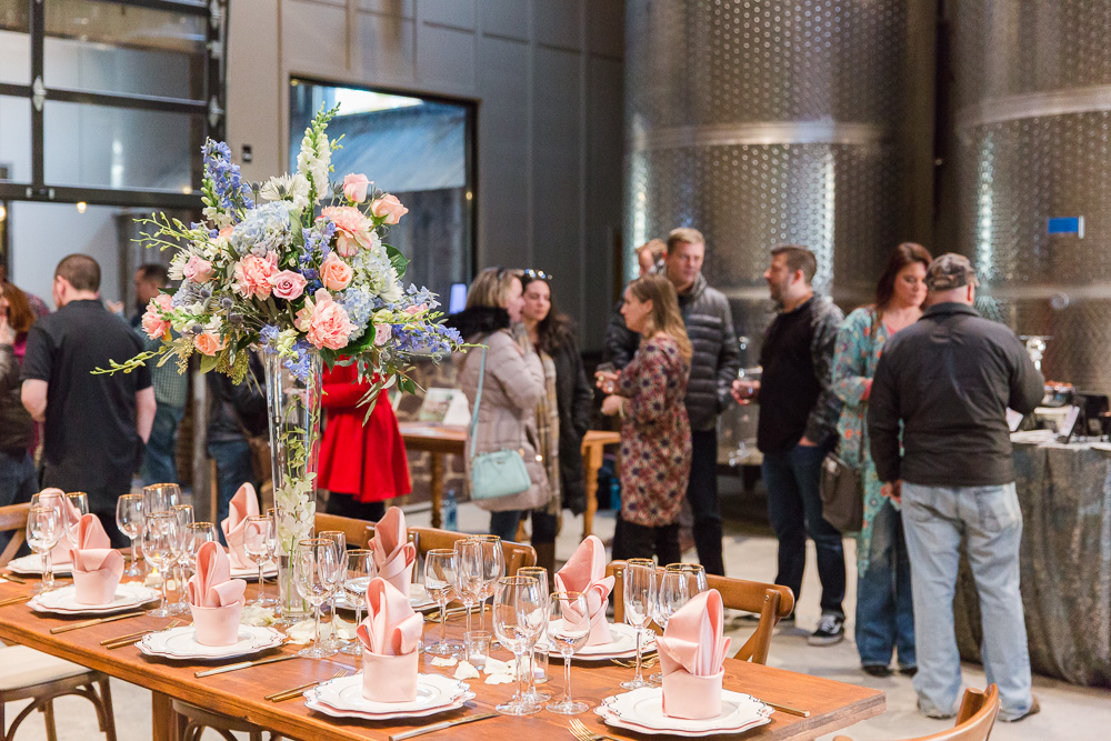 Beautiful floral centerpiece from Flower Gallery of Manassas with barn table rental from Honeywood Rentals | Bull Run Winery Wedding Photography | Megan Rei Photography