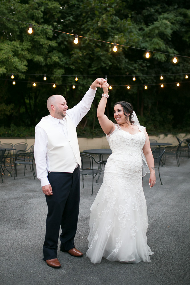 Husband and wife dancing at their wedding reception