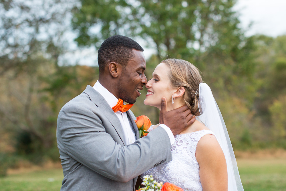 Groom pulls bride in for a kiss