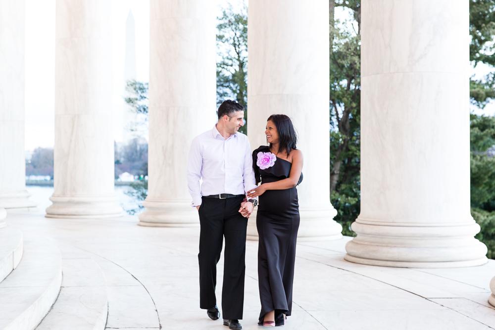 Walking through the columns at the Jefferson Memorial in Washington DC | Northern Virginia Maternity Photographer