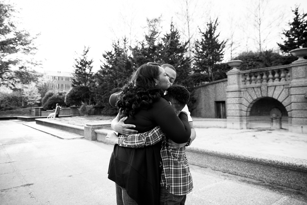 A sweet family hug in front of the Meridian Hill fountain | Washington, DC Documentary Photographer