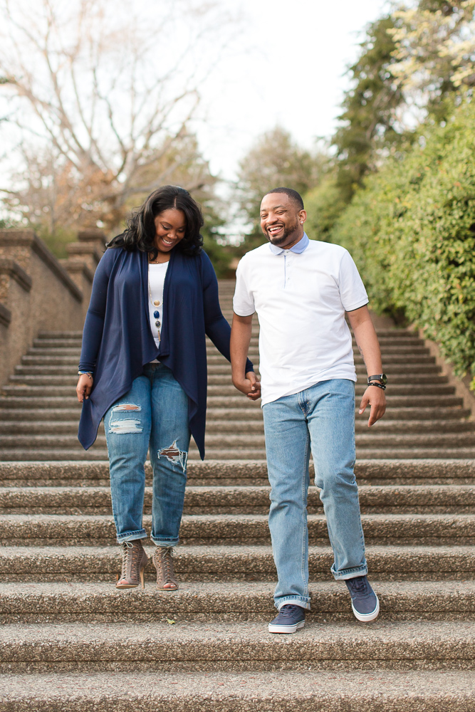 Newly engaged couple walking down the stairs during their engagement photo session | Meridian Hill Park Engagement Photos | Best Engagement Picture Locations in DC