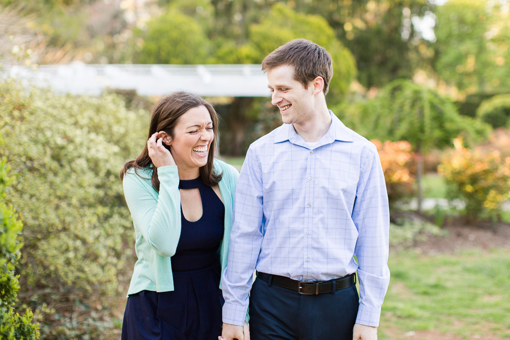 Happy couple laughing during their engagement shoot | Northern Virginia