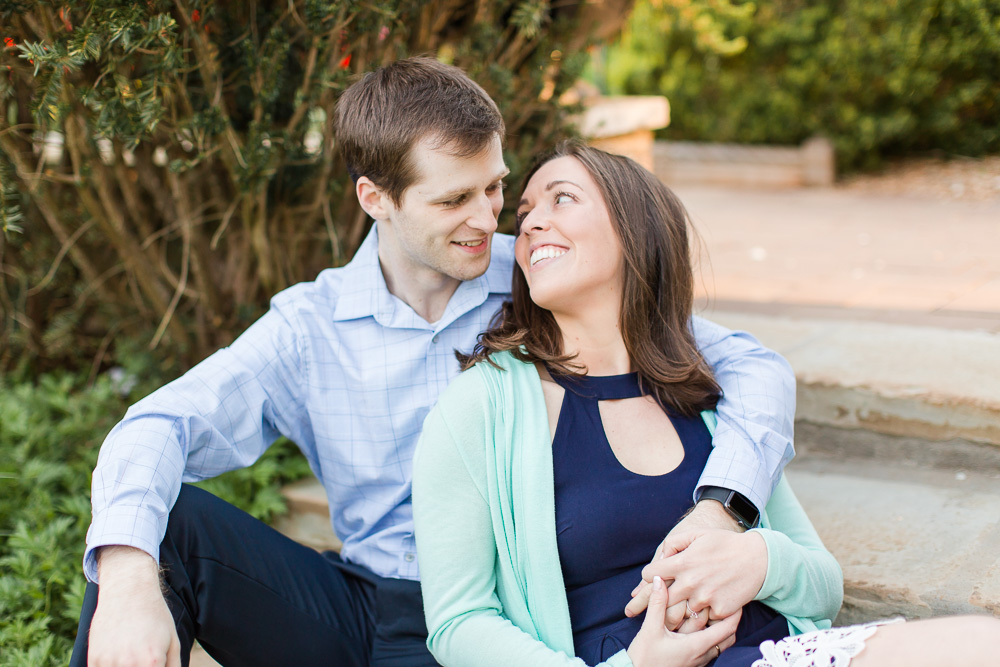 Sweet photo of engaged couple sitting on the garden steps | Candid Engagement Photography
