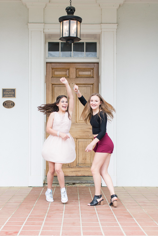 Best friends dancing on the front porch of the Glenview Mansion | Candid Photographer in Rockville, MD