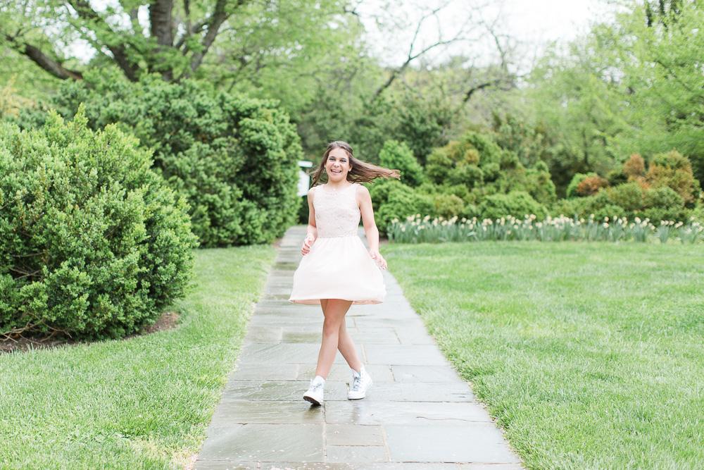 Having fun twirling in her pink dress at her Bat Mitzvah | Glenview Mansion, Rockville MD | Megan Rei Photography