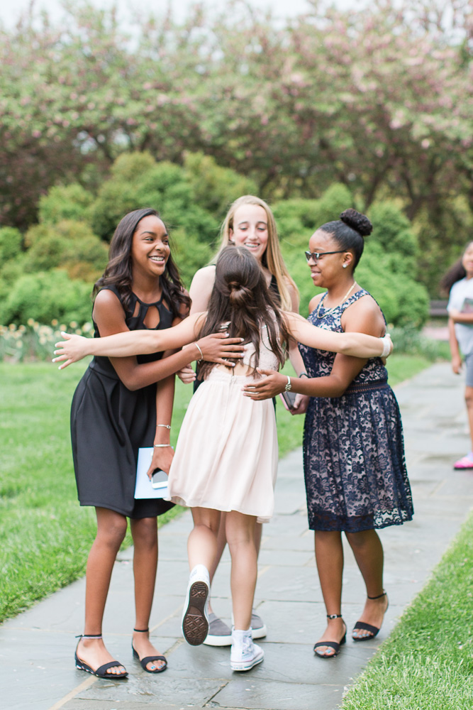 Giving a big hug to her friends as they arrive at Glenview Mansion | Rockville, MD Candid Photographer