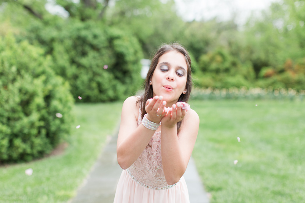Cute Bat Mitzvah photo blowing the cherry blossom petals | Rockville, MD Bat Mitzvah at the Glenview Mansion