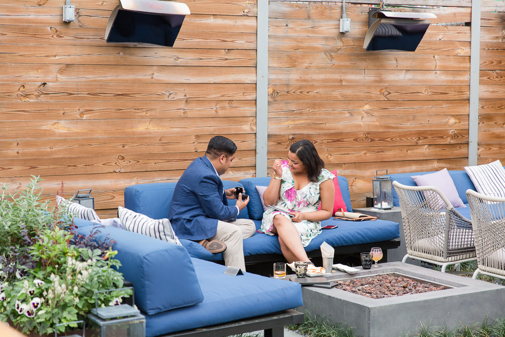 Showing her the ring | Surprise wedding proposal at Masseria in Union Market | DC Proposal Photographer