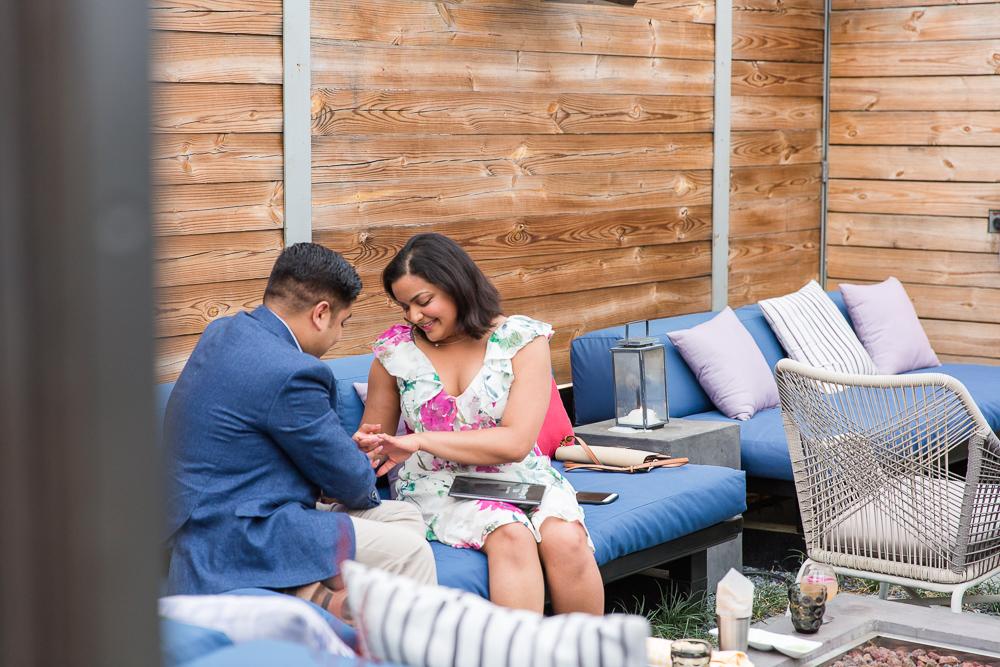 Putting on the engagement ring | Masseria restaurant proposal | Union Market, DC