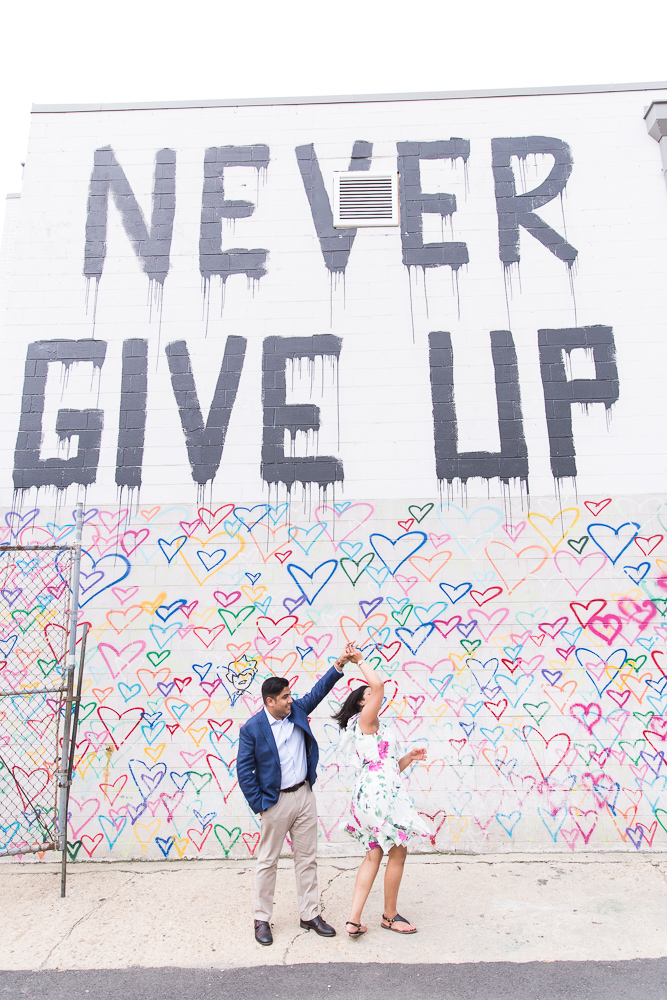 Dancing by the Never Give Up mural and heart wall | Heart Wall Engagement