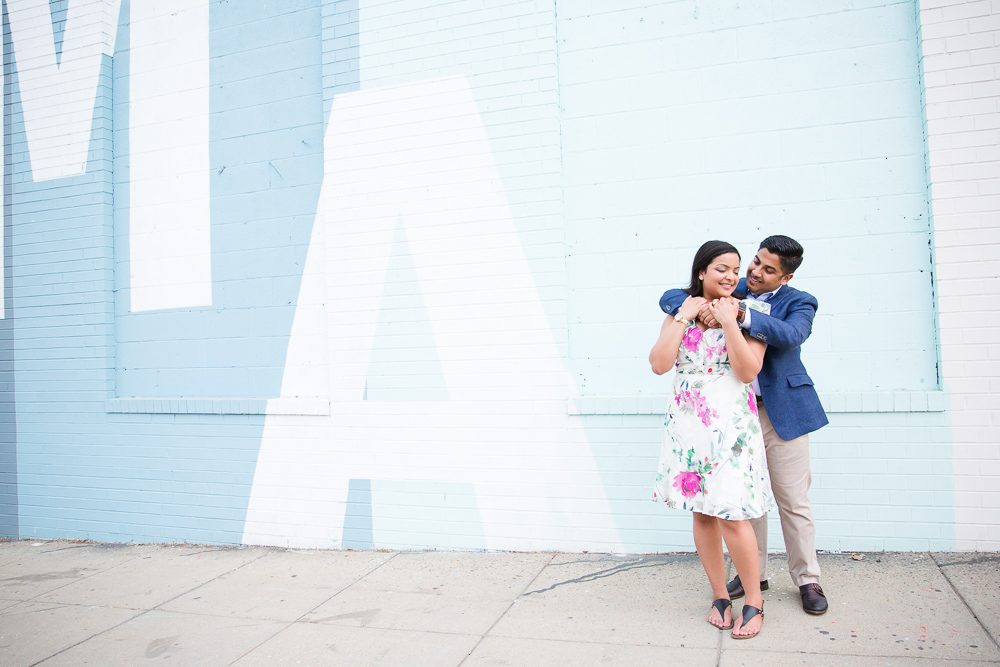 Engaged couple in front of the blue mural at Union Market | Best DC Engagement Photography