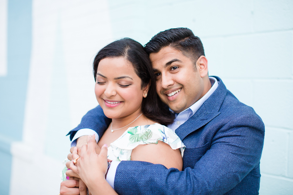 Newly engaged couple getting cuddly during their engagement session at Union Market | Washington, DC Engagement Session | Megan Rei Photography