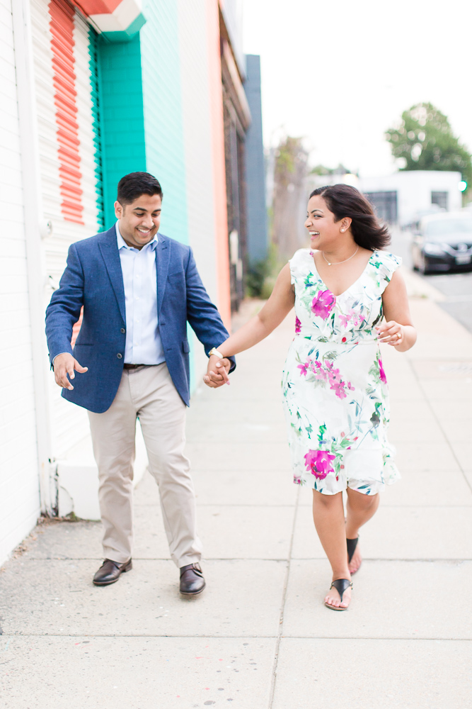 Couple laughing during their engagement session at Union Market | Candid DC Engagement Photographer