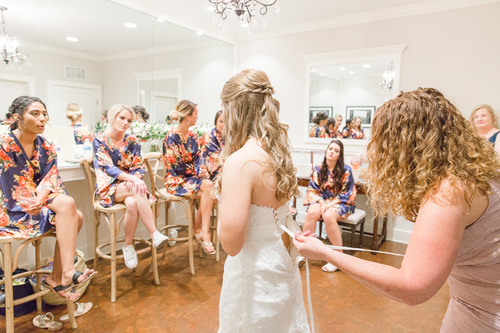 Putting on the wedding dress | Candid Charlottesville Wedding Photographer