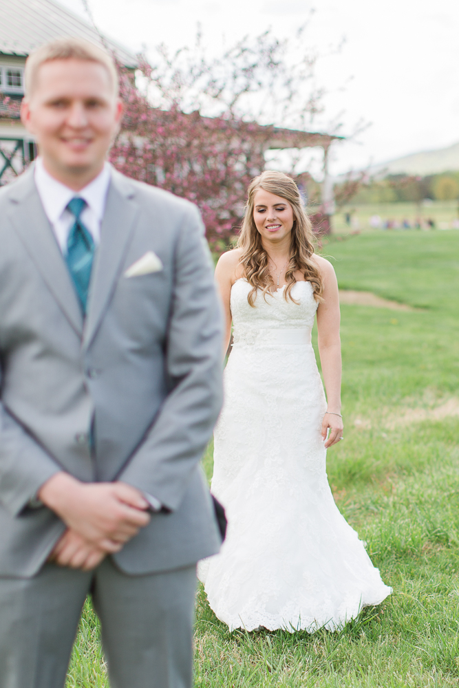 Bride walking up to the groom for their First Look photos at King Family Vineyards | Best Charlottesville Wedding Venue