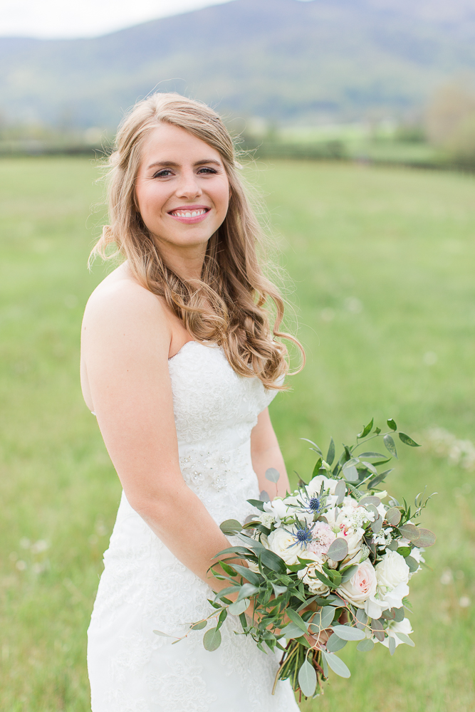 Bridal portrait at King Family Vineyards | Hair and makeup by Glo-Out Glamour Bar | Dress from Ava Laurenne Bride | Flowers from Foxtail Cottage