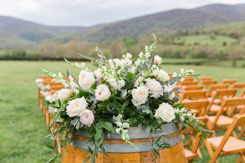 Winery wedding décor with flowers on a wine barrel | Winery Wedding Venue in Crozet, VA | King Family Vineyards venue and flowers by Foxtail Cottage Floral