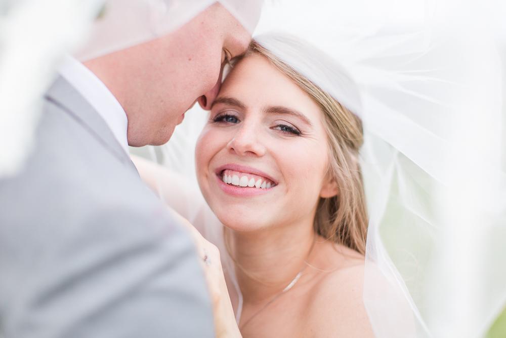 Beautiful candid photo of bride under her veil | Crozet Wedding Photographer