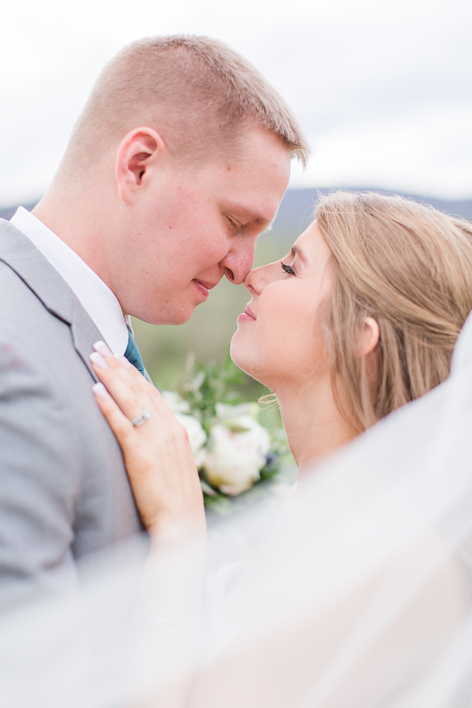 Bride and groom wedding picture with veil at King Family Vineyards, Crozet Virginia | Megan Rei Photography