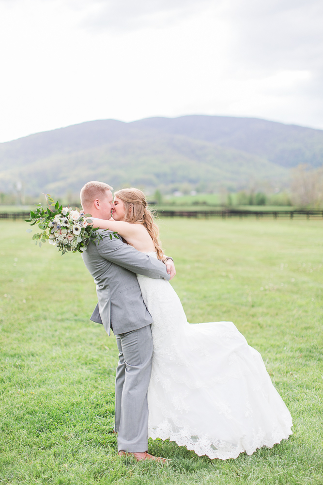 Groom lifting the bride for a kiss