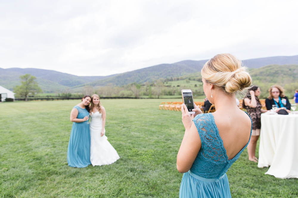 Bridesmaids taking pictures during cocktail hour