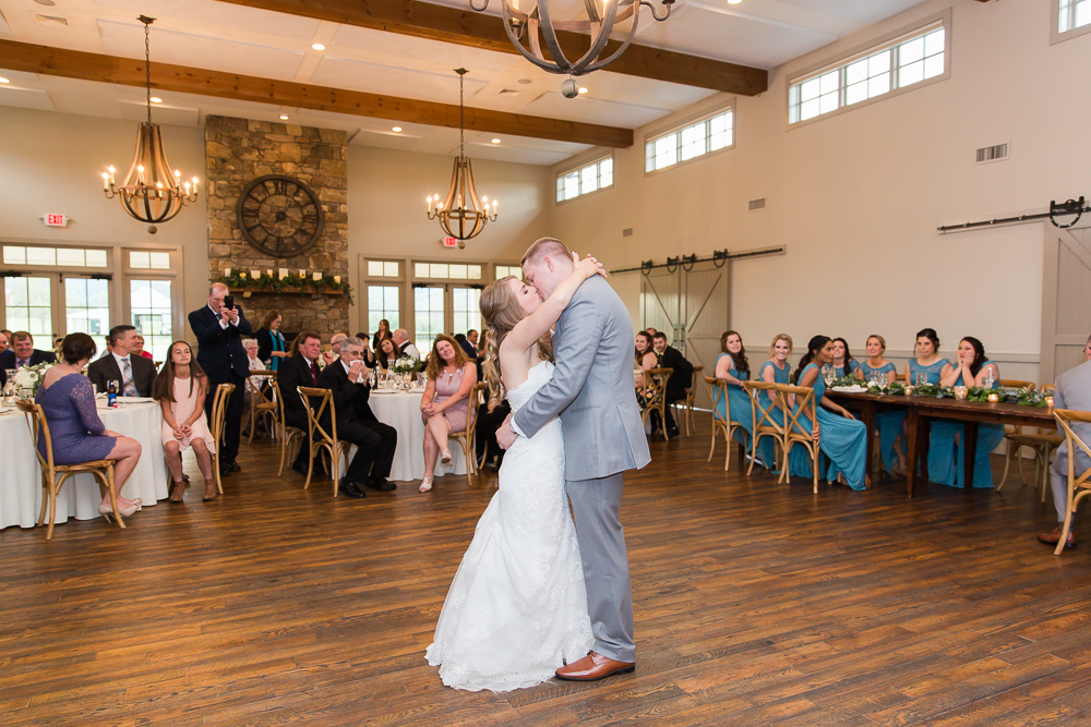 Wedding couple kisses during their first dance at King Family Vineyards | Candid wedding photos in Crozet, Virginia
