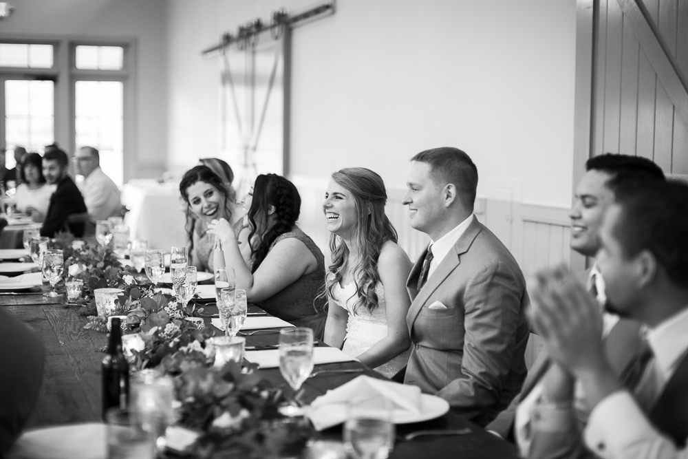 Candid wedding reception picture of bride laughing during the toasts | Charlottesville Virginia Wedding Photographer