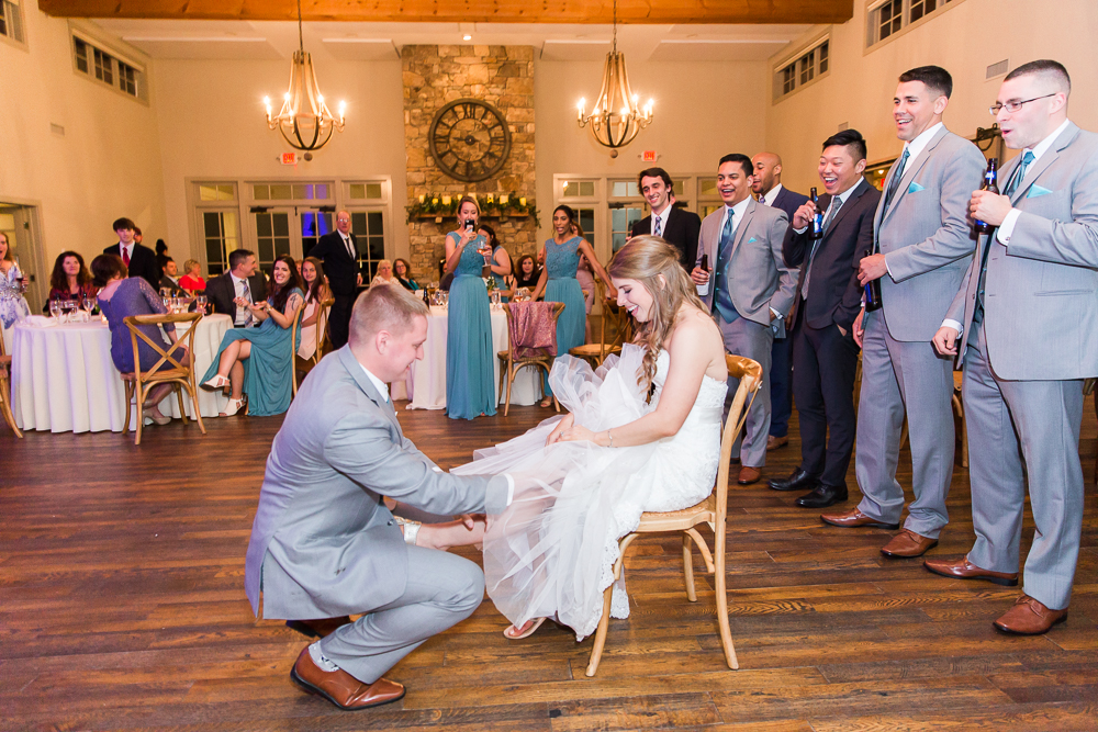 Taking off the garter during wedding reception at King Family Vineyards