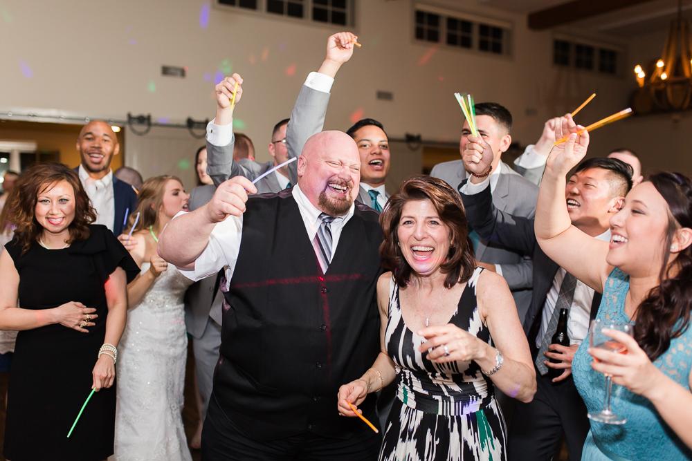 Wedding guests having fun on the dance floor at King Family Vineyards | Candid dancing photos in Crozet, Virginia