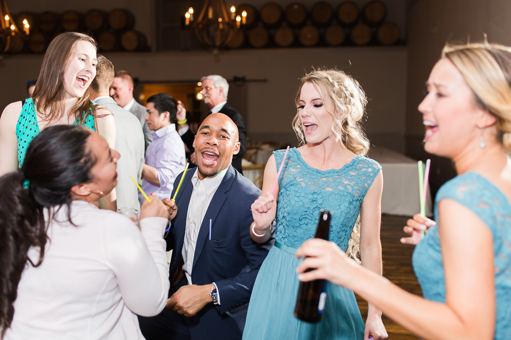 Wedding guests having fun on the dance floor at King Family Vineyards | Candid dancing photos in Crozet, Virginia | Guyton Mobile DJ