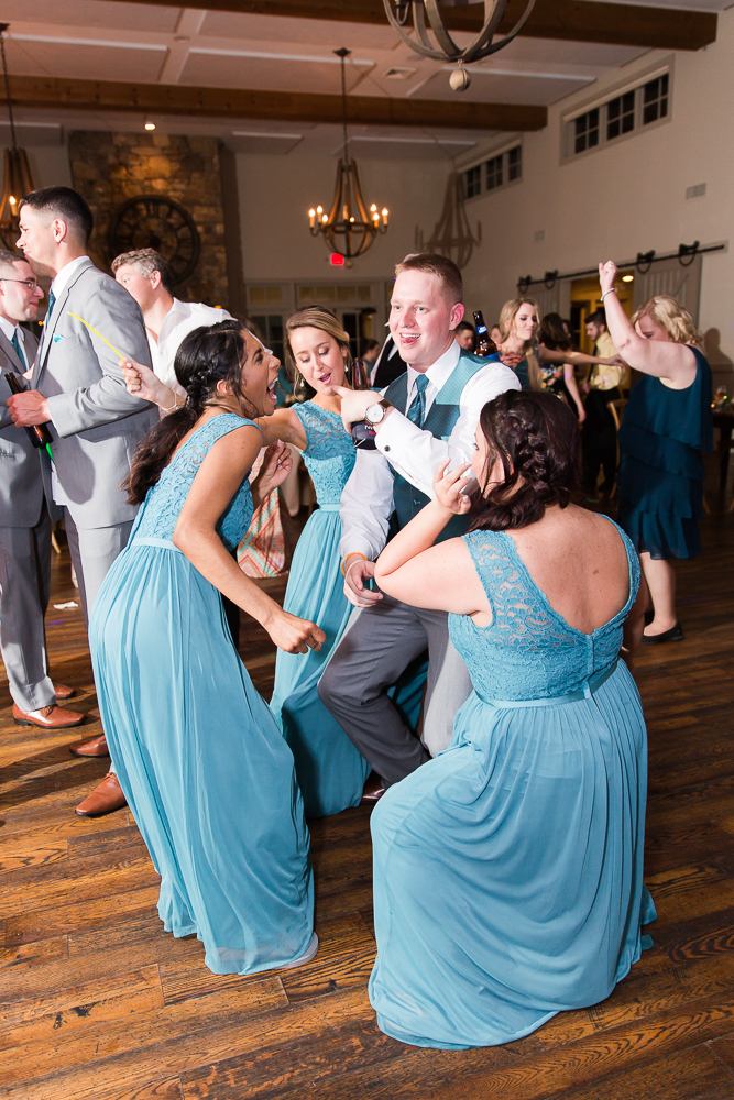Groom dancing with the bridesmaids during the wedding reception in Crozet, Virginia