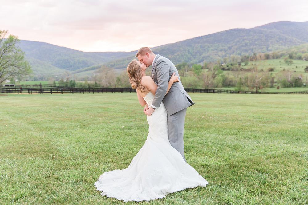 Beautiful sunset wedding photo with Blue Ridge Mountains at King Family Vineyards | Charlottesville Wedding Photographer | Megan Rei Photography