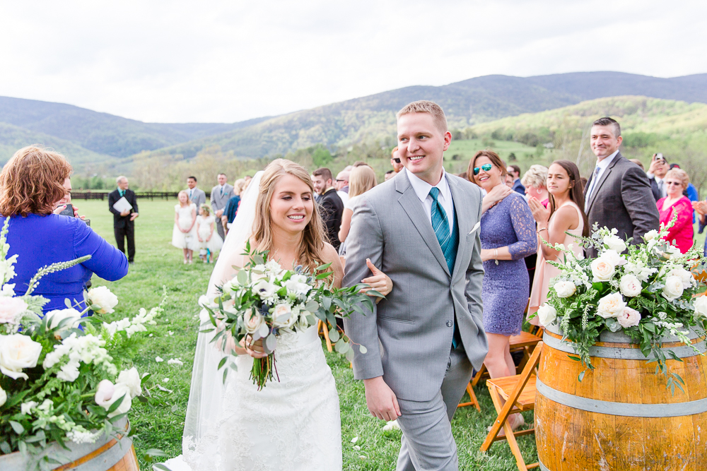 Bride and groom recessional after the ceremony | King Family Vineyards wedding venue in Crozet, VA
