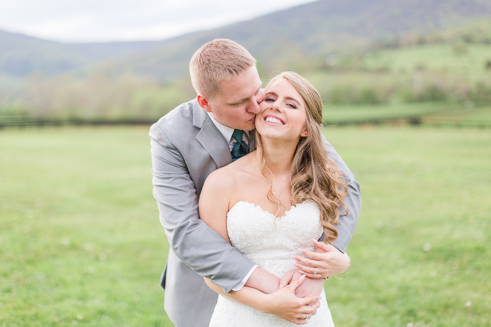 Sweet picture of groom giving the bride a kiss | King Family Vineyards Wedding Pictures | Crozet Wedding Venue