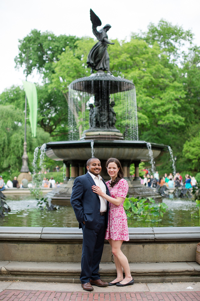 Engaged couple posing by the Bethesda Fountain | Central Park Engagement Pictures