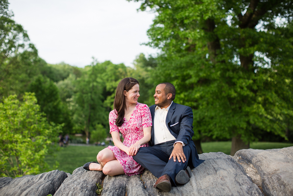 Sitting on the big rocks in Central Park during their engagement shoot | Best places for engagement pictures in Central Park, New York City | Megan Rei Photography