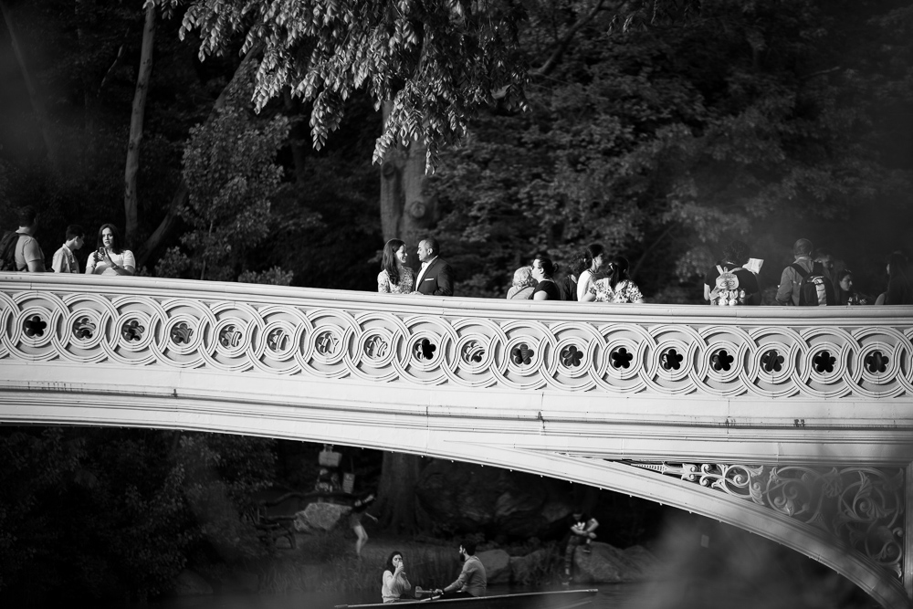 Engaged couple on the Bow Bridge in Central Park