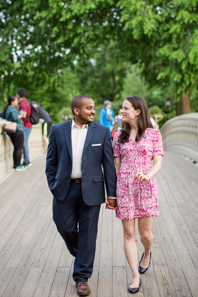Holding hands and walking on the Bow Bridge | Best spots for engagement pictures in Central Park, New York | Megan Rei Photography