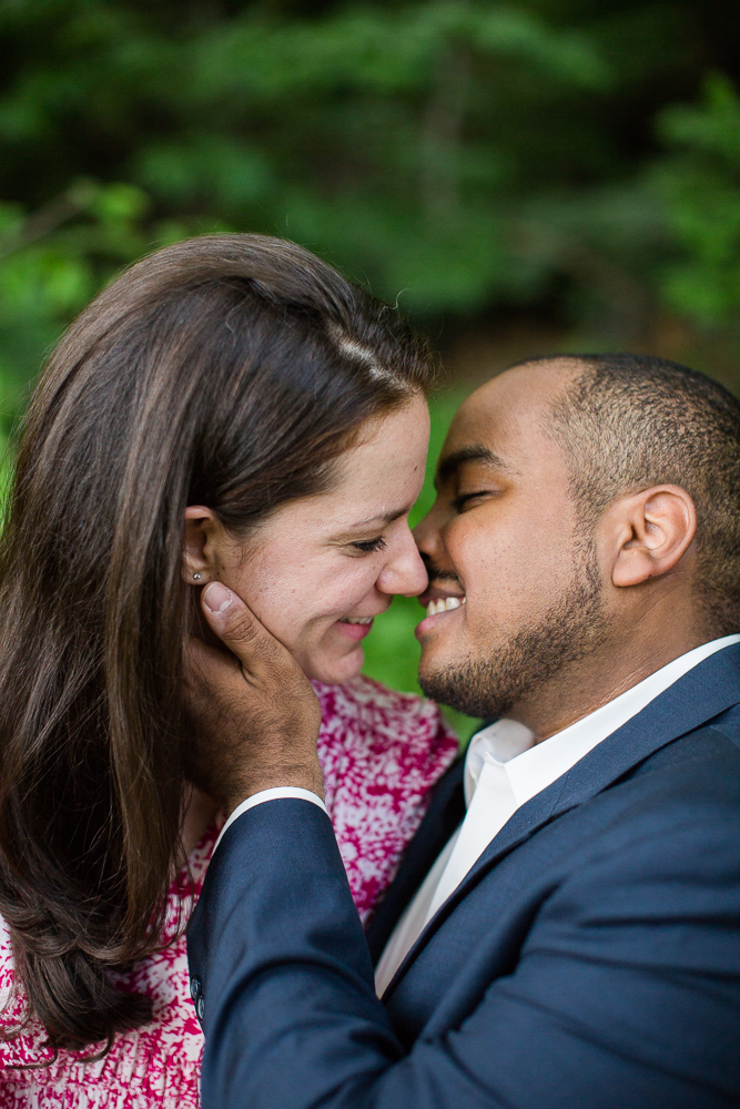 Leaning in for a kiss during their engagement session