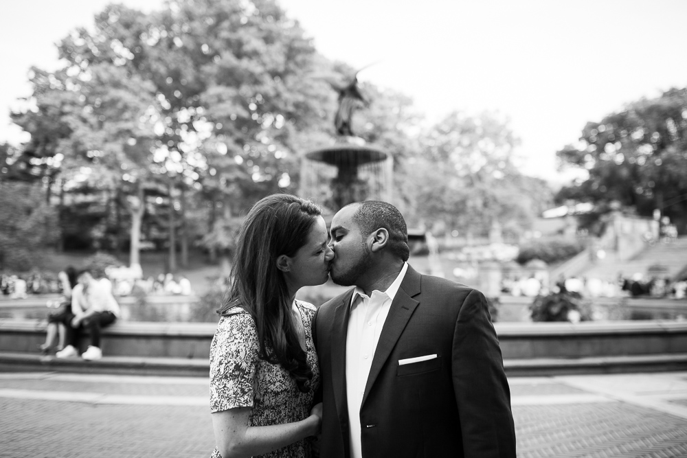 Engaged couple kisses in front of the Bethesda Fountain in Central Park | New York City Engagement Photographer