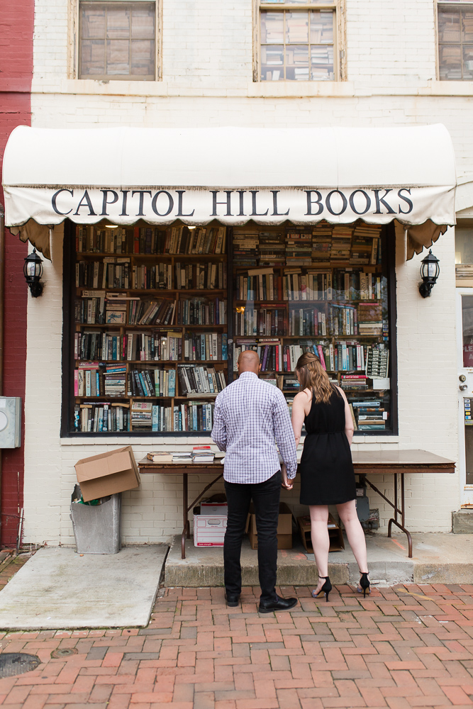 Browsing the stacks of books at Capitol Hill Books