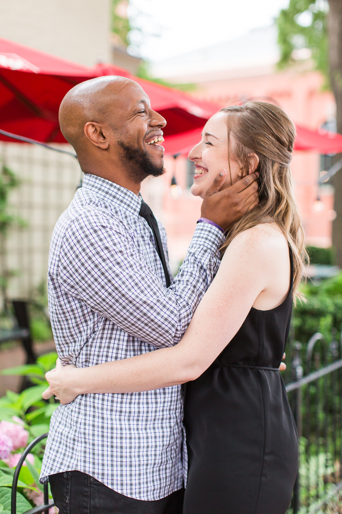 Fun engagement picture of couple laughing in Capitol Hill neighborhood of Washington, DC