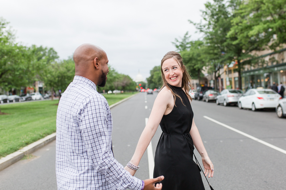 Looking back at her fiance as they cross the street in DC