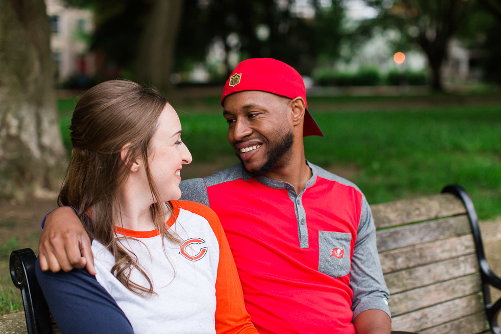 Smiling couple during engagement photos at Lincoln Park, DC